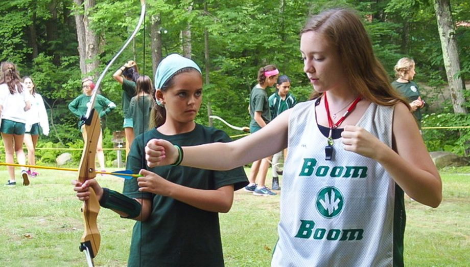 Camper learning archery