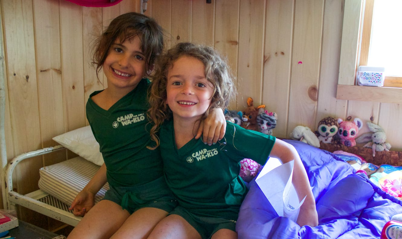 Two young campers in their bunk