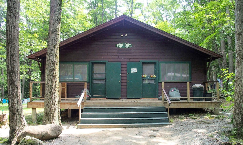 Girl's cabin nestled in the woods