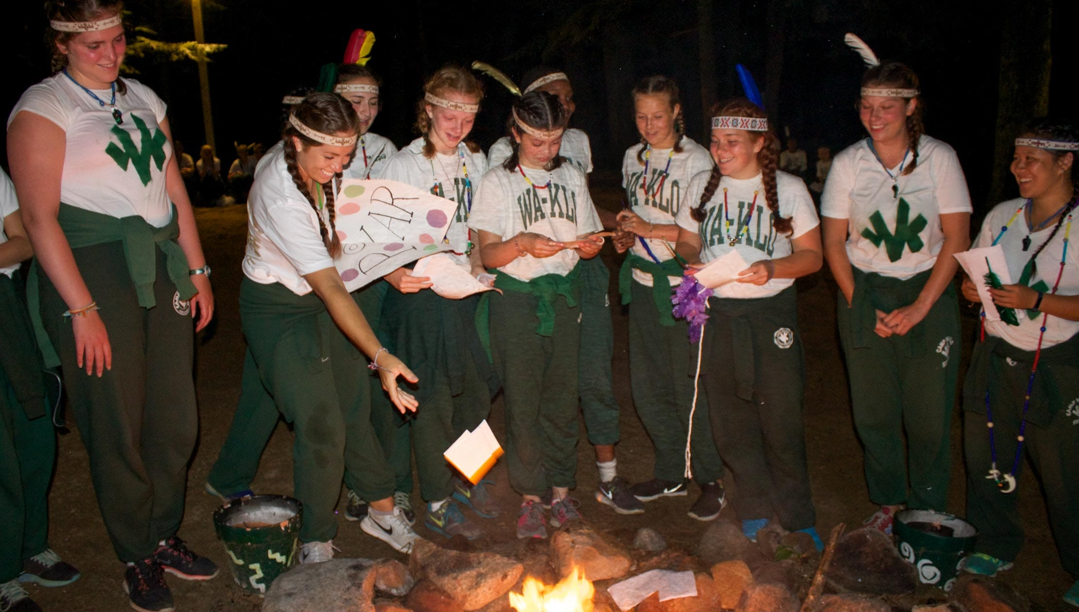 Girls burning notes at the council fire