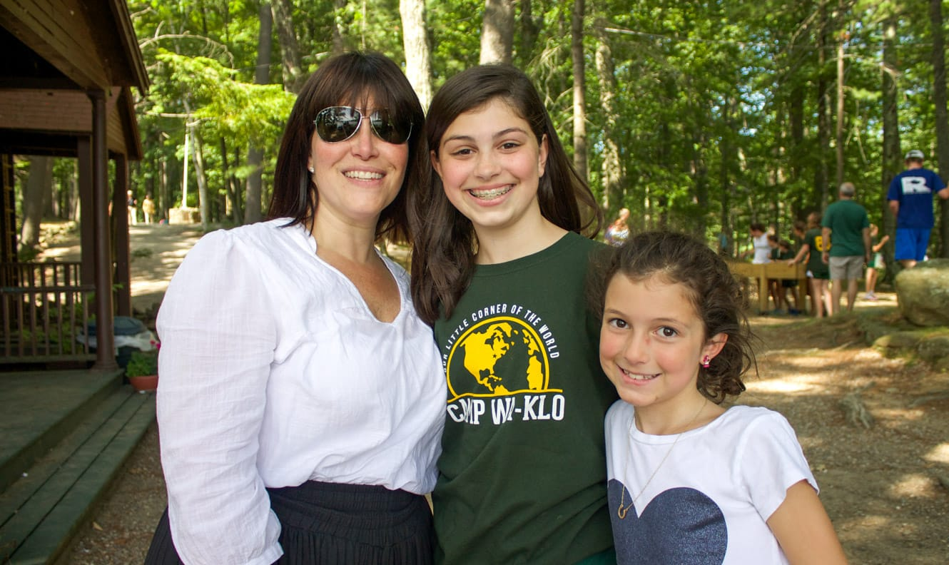 Mother and daughters at family camp