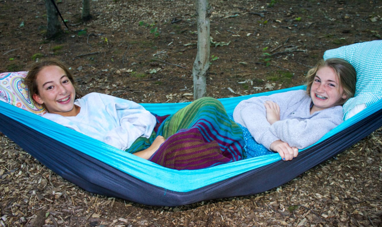 Two girls laying on a hammock