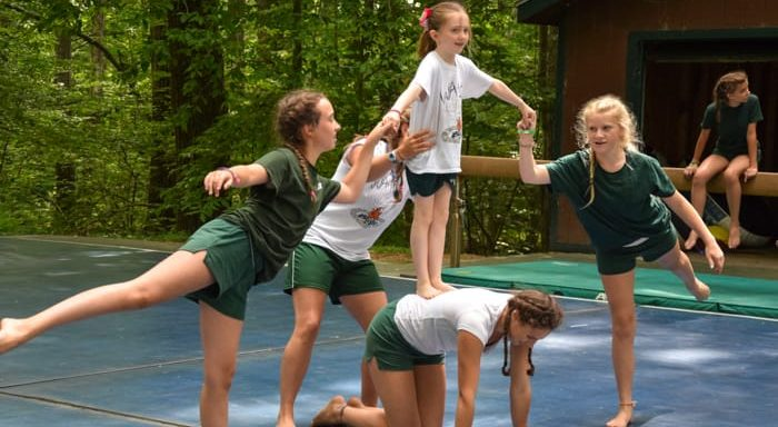 Girls practicing gymnastics or cheering