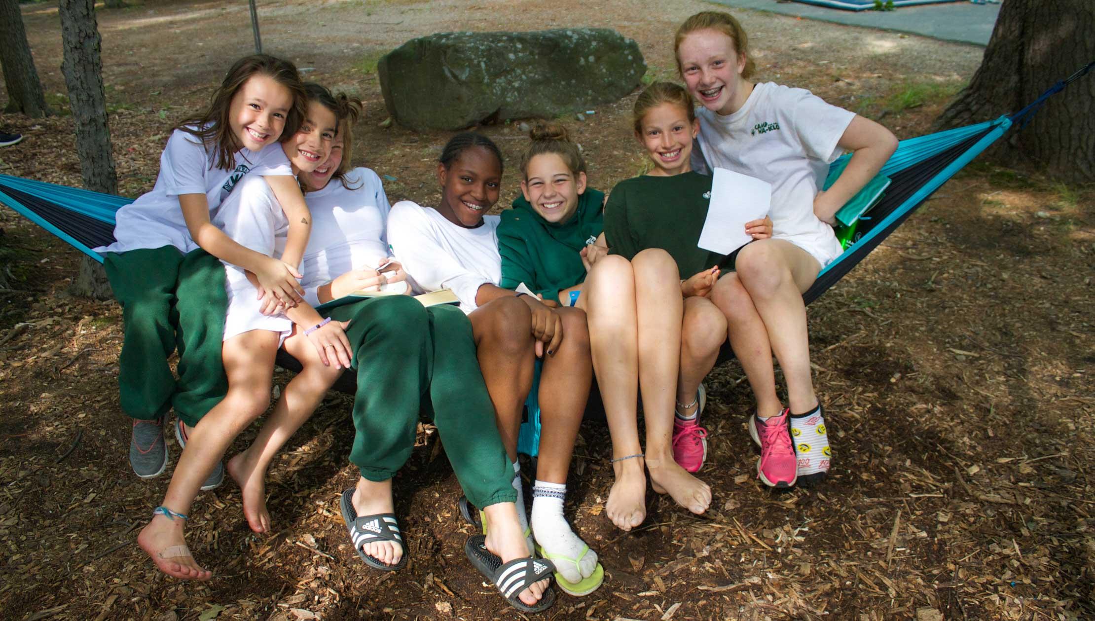 Group of girls in hammock reading
