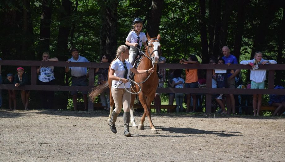 Riding a horse in a equestrian competition