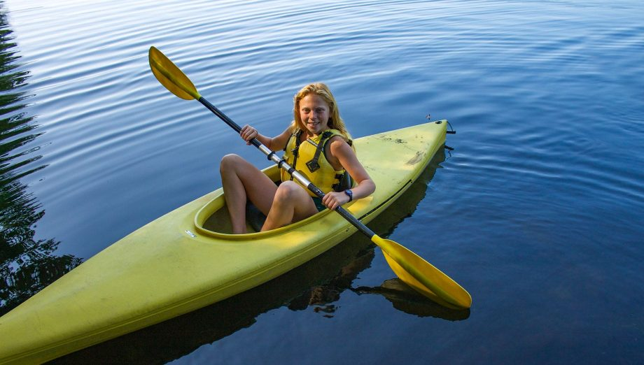 Camper in yellow kayak
