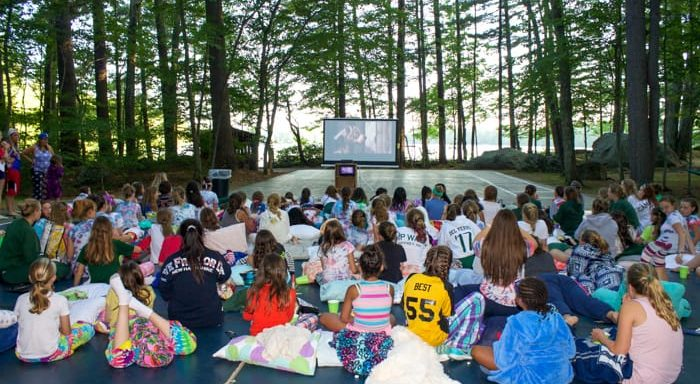 Campers watching an outdoor movie