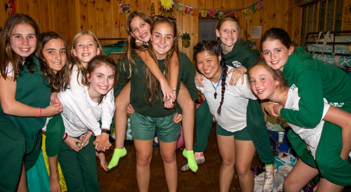 Campers piggybacking on staff in cabin