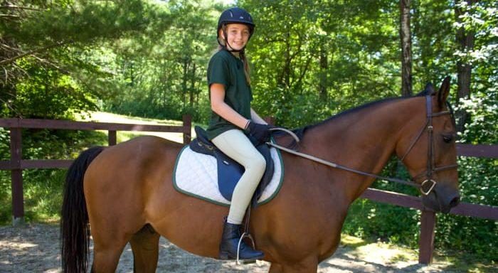 Camper riding a horse