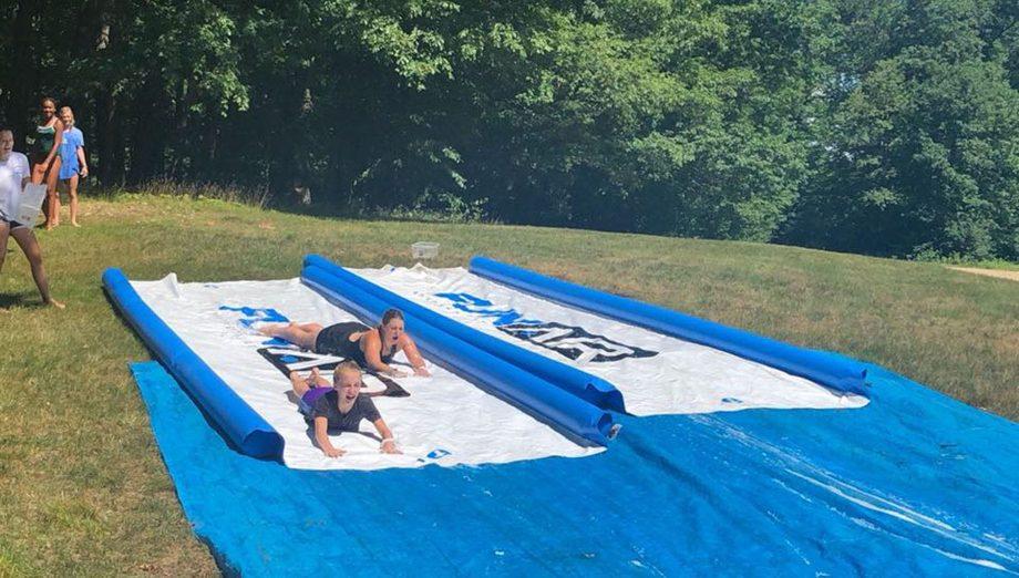 Campers going on slip-n-slide