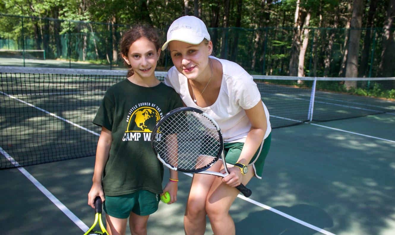 Tennis instructor and camper